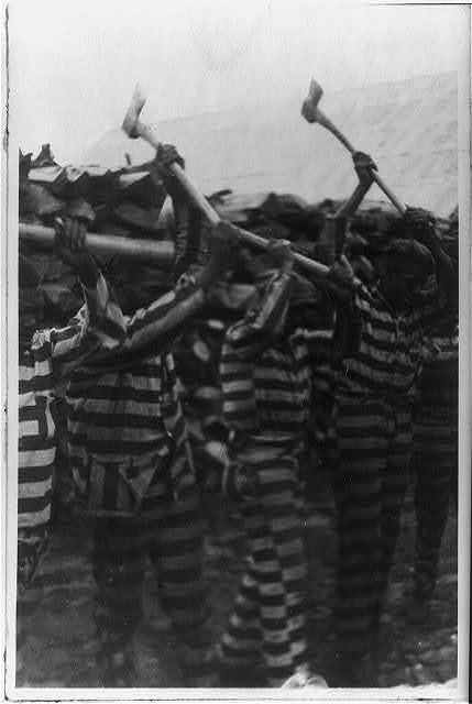 A group of Black men in a chain gang